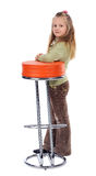 Girl next to a high stool, isolated Stock Photos