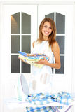 girl next to ironing board Stock Image