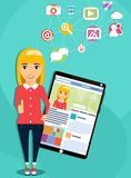 Girl next to a tablet computer. The concept of social networking. The girl next to a tablet computer showing a social network. Personal page of a social network Royalty Free Stock Photography