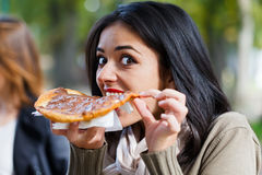 Girl Nibbling Chocolate Scone Royalty Free Stock Photos