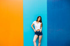girl with nice body against color wall background Royalty Free Stock Photography
