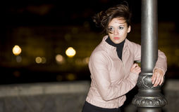 Girl at night. Misterious image of a young beautiful girl at night Royalty Free Stock Photography