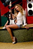 Girl in night club with electrical guitar Royalty Free Stock Photo