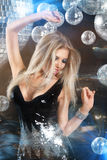 Girl at night disco club. Young blonde woman dancing at night disco club Royalty Free Stock Images