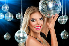 Girl at night disco club. Young blonde woman dancing at night disco club Stock Photos