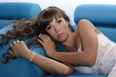 Girl. In the nightclub is on a blue couch Royalty Free Stock Photo