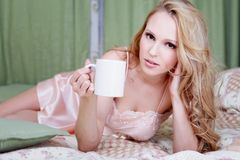 Girl in nightgown with cofee Royalty Free Stock Photos
