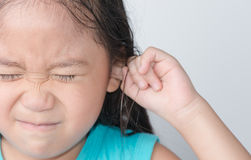 Girl in a noisy place. On a gray background royalty free stock image