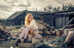 Girl not background firewood Stock Photography