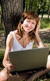 Girl with a note-book outdoor Stock Photos