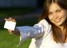 Girl with note card Royalty Free Stock Photo