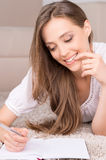 Girl with note pad. Stock Image