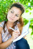 Girl with notebook Stock Photos