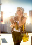 Girl with notebook and coffee cup on street at sunny day Royalty Free Stock Image