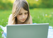 Girl with notebook computer Stock Image