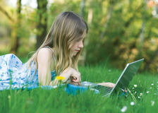 Girl with notebook computer Stock Images