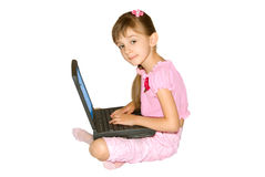 The girl with a notebook computer 3. The girl in pink clothes sits with a notebook computer Stock Image