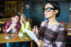 Girl with a notebook. Girl with pen and notepad Stock Images