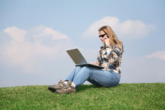Girl with notebook on grass royalty free stock image