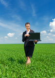 Girl with notebook at green field Stock Photography
