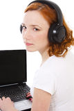 Girl with notebook and headphones Stock Photo
