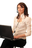 Girl with a notebook in headsets Royalty Free Stock Images