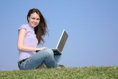 Girl with notebook on meadow Stock Image