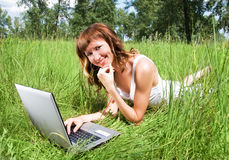 Girl with a notebook outdoor Royalty Free Stock Image