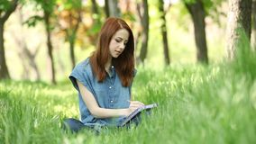 Girl with notebook stock video footage