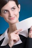 Girl with notecard. Young woman with notecard, smiling Royalty Free Stock Photos