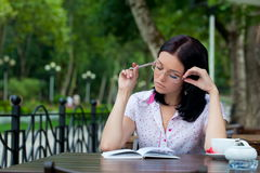 Girl with notepad in cafe Stock Image