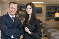 A girl with notepad and a man in suits standing Royalty Free Stock Photos