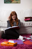 Girl with notes before exam Royalty Free Stock Image