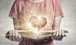 Girl with novel book Royalty Free Stock Images