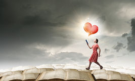 Girl with novel book Royalty Free Stock Photos