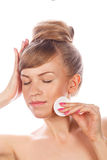 Girl with nude makeup holds a cotton pad. Royalty Free Stock Photos