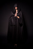 Girl in nun outfit. Isolated on black background stock images