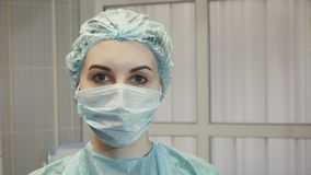 Girl nurse in the operating room in a medical mask. Girl nurse in the operating room Royalty Free Stock Images