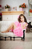 Girl in the nursery in pink dress Royalty Free Stock Image