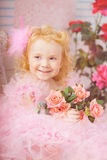 Girl in the nursery in pink dresses Stock Photography