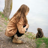 Girl with nutria Royalty Free Stock Photo