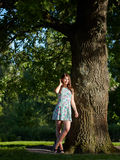 Girl and Oak Royalty Free Stock Image
