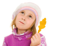 Girl with an oak leaf in her hand Royalty Free Stock Photos