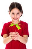 Girl with oak sapling in hands Royalty Free Stock Photos