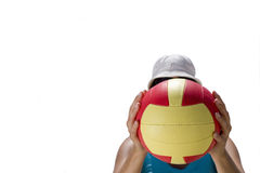 Girl obscuring face with ball, low angle view, cut out Royalty Free Stock Image