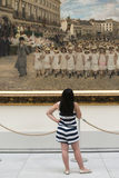 A girl observes a large painting Royalty Free Stock Photo