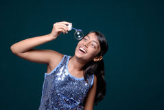 Girl observing hanging soap bubble Royalty Free Stock Photos