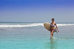 Girl  on an ocean coast with a board for surf Royalty Free Stock Images