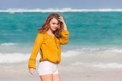 Girl on the ocean coast in Dominican Republic. Beautiful Caucasian teenage girl walking on the ocean coast in Dominican Republic Royalty Free Stock Image