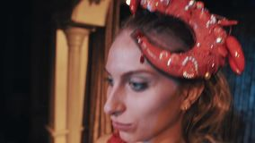 Girl in ocean red shrimp cabaret costume showing her cleavage dancing on scene. Close up stock video footage